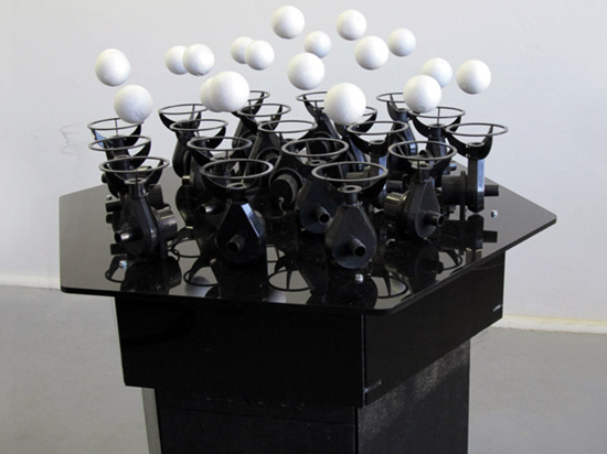 This was an invention that floated ping pong balls in a sequence with a musical composition