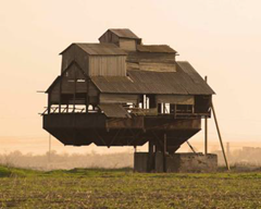 """This """"gravity defying"""" home is real. It is supported by a single cantilever.  The owners use it as a barn for storage of mineral fertilizers."""