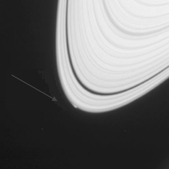 Cassini photo showing possible birth of new Saturn moon