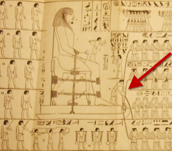 This Egyptian drawing shows slaves pulling a huge statue while another man pours water in front of the sled