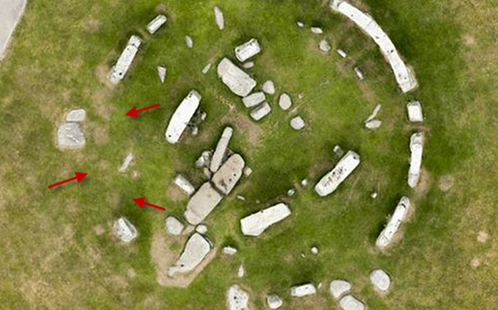 Dry patches in the grass indicate the positions where stones once lay at Stonehenge